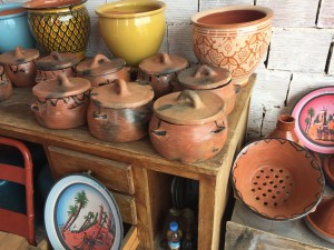 Unglazed, hand-made pots with lids
